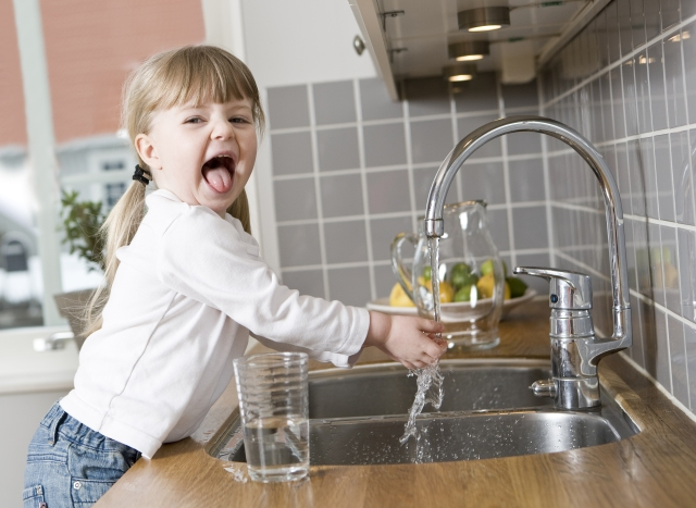 Girl with kitchen faucet